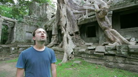Tourist surprise in bizarre nature of preah khan temple, angkor Stock Photos