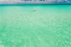 Tourist swimming in clear waters of Bahamas Stock Photo