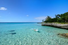 Coral beaches in Cuba. Tourist swimming in turquoise waters of the Caribbean sea on the wild noon coast of Cuba Stock Image