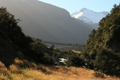 Tourist on swing-bridge in Mount Aspiring National Park Royalty Free Stock Photography