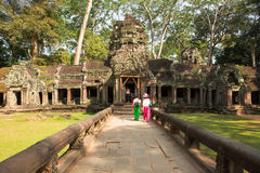 Tourist in Ta Prohm temple. In Angkor Wat, near Siem Reap, Cambodia, South East Asia Royalty Free Stock Image