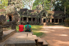 Tourist in Ta Prohm temple. In Angkor Wat, near Siem Reap, Cambodia, South East Asia Royalty Free Stock Images