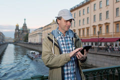 Tourist with a tablet in St. Petersburg, Russia Stock Image