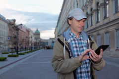 Tourist with a tablet in St. Petersburg, Russia Royalty Free Stock Image