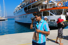 Tourist take photo in cruise trip - Greece Stock Images