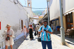 Tourist take photo in Greek alley - Greece Stock Photos
