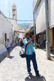 Tourist take photo in Greek alley - Greece Stock Images