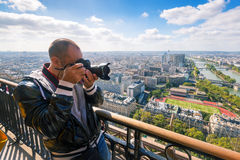 Tourist take picture of Paris from the Eiffel Tower. France Stock Image