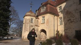 Tourist take pictures near the medieval castle stock video