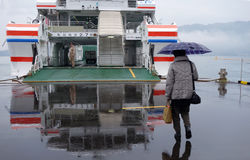 Tourist takes ferry to Miyajima, Japan. MIYAJIMA, JAPAN - DECEMBER 12: Tourist takes ferry to Miyajima, Japan on December 12, 2014. The ferries depart frequently Royalty Free Stock Images