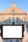 Tourist takes photo of Basilica in Padua, Italy. Travel concept - tourist photograph facade of Basilica di Sant ' Antonio da Padova in Padua, Italy on tablet pc Stock Photo