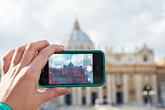 Tourist takes photo camera mobile at cathedral of saint peter in Royalty Free Stock Photos