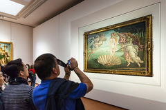 Tourist takes photo in room of Uffizi Gallery Stock Photography