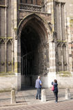 Tourist takes picture of dom tower in utrecht Stock Images