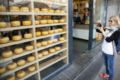 Tourist takes picture of dutch cheeses in Amsterdam Stock Image