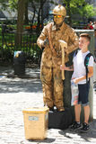Tourist takes picture with firefighter human statue in Lower Manhattan. NEW YORK - JULY 16, 2017: Tourist takes picture with firefighter human statue in Lower stock photos