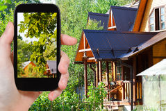 Tourist takes picture of yard of village house Stock Photography