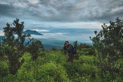 Tourist takes a snapshot of the Batur volcano from Kintamani, Ba Royalty Free Stock Photo