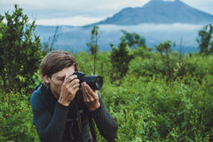 Tourist takes a snapshot of the Batur volcano from Kintamani, Ba Royalty Free Stock Image