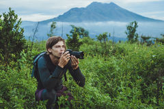 Tourist takes a snapshot of the Batur volcano from Kintamani, Ba Royalty Free Stock Photos