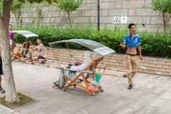 Tourist takes a walk on stretchers Stock Photos