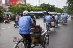 Tourist taking a cyclo ride Stock Image