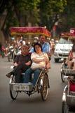 Tourist taking a cycro ride. Stock Photo