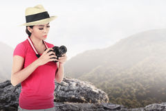 A tourist taking image with camera Royalty Free Stock Image