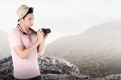 A tourist taking image with camera Stock Photo