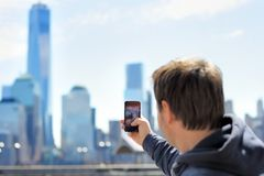 Tourist taking mobile photo of skyscrapers Royalty Free Stock Photography