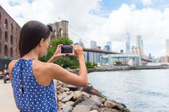 Tourist taking mobile picture of New York skyline Royalty Free Stock Photos