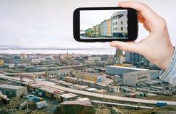Tourist taking photo of Anadyr town skyline Stock Photo