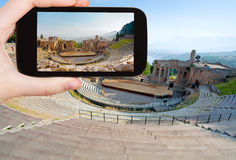 Tourist taking photo of ancient amphitheater Stock Photo