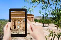 Tourist taking photo ancient Temple of Concordia Stock Photos
