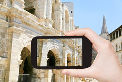 Tourist taking photo of Arles Amphitheatre Royalty Free Stock Photos