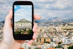 Tourist taking photo of Athens city skyline Stock Images