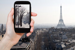 Tourist taking photo of Avenues in Paris in spring. Travel concept - tourist taking photo of Avenues in Paris in early spring on mobile gadget, France Royalty Free Stock Photo