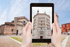Tourist taking photo of Baptistery in Parma Stock Image