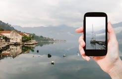 Tourist taking photo of Bay of Kotor Royalty Free Stock Photo