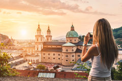 Tourist taking a photo of beatiful sunset in Salzburg Austria. Tourist taking a photo with mobile of beatiful sunset in Salzburg Austria stock images