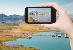 Tourist taking photo of Boulder Beach on Lake Mead Stock Photos