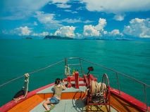 Tourist taking photo on bow of ferry heading to Samui, Thailand Royalty Free Stock Image