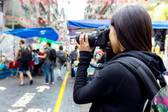 Tourist taking photo with camera Stock Photography