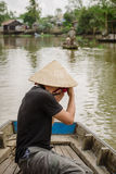 Tourist taking photo of Can Tho floating market on Mekong delta Royalty Free Stock Photos
