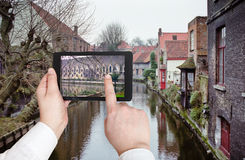 Tourist taking photo of canal in Bruges Stock Photo