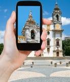 Tourist taking photo of Carmo Church in Faro Royalty Free Stock Photos