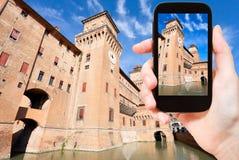 Tourist taking photo of Castle Estense in Ferrara Stock Photos