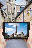Tourist taking photo of Cathedral in Treguier Royalty Free Stock Image