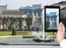 Tourist taking photo of cityscape Salzburg Royalty Free Stock Photos