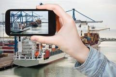 Tourist taking photo of Copenhagen cargo seaport Stock Photo